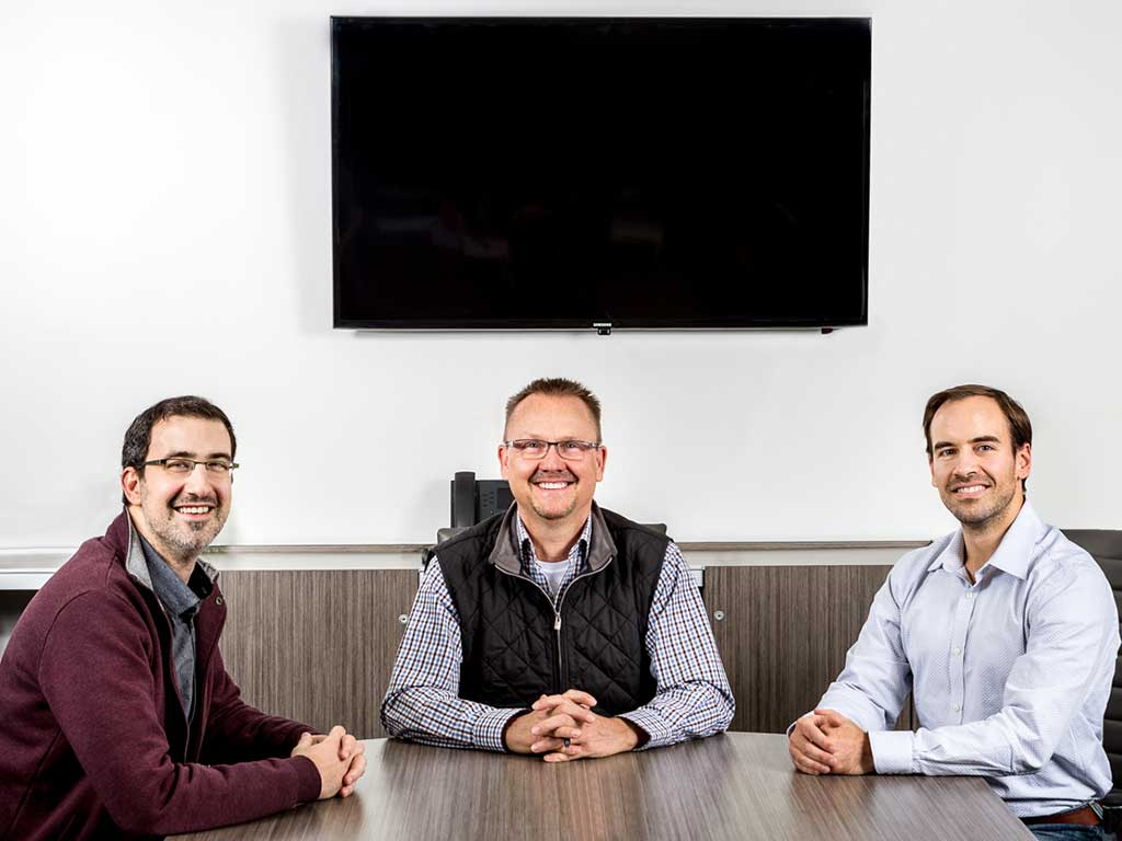 Photo of the founders of OneWall Communities