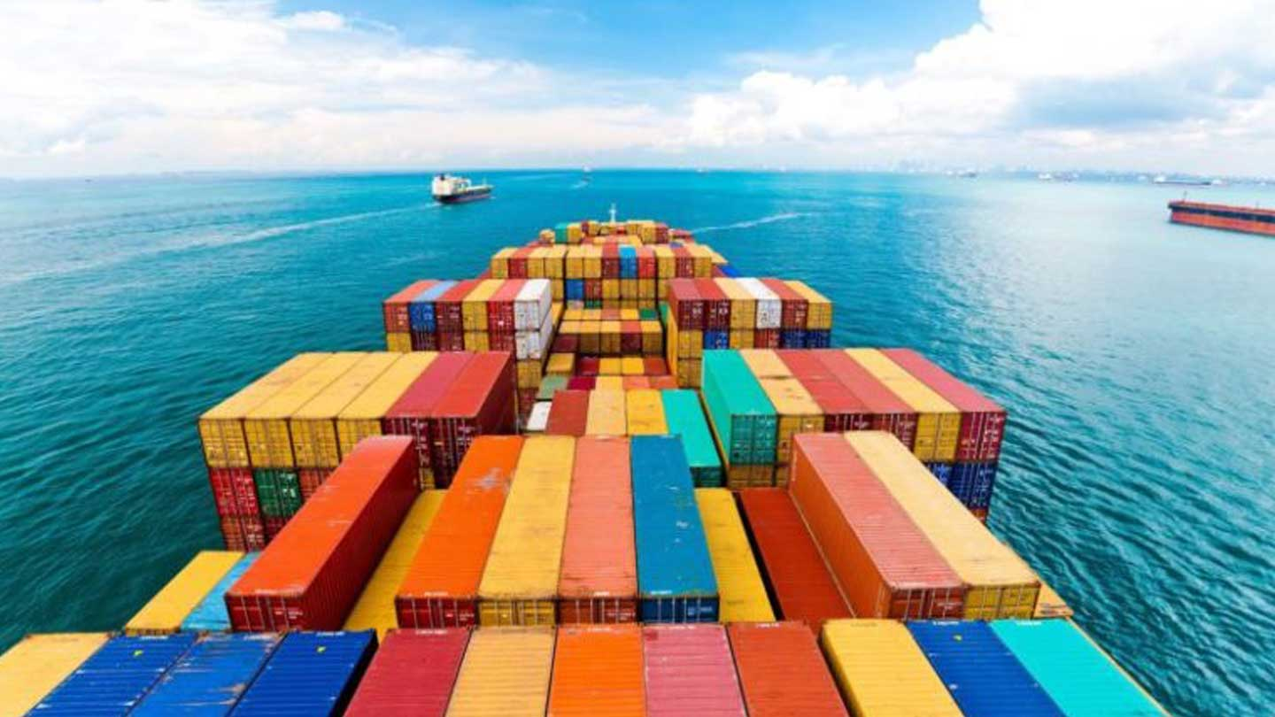 Cargo ship on the water with multi-colored shipping containers