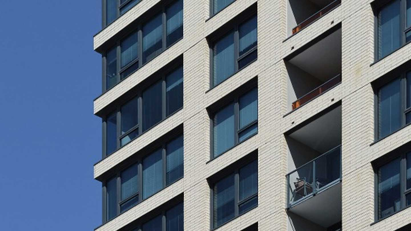Exterior of a multifamily building windows and balconies